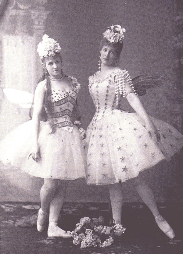 "A photograph from 1890 of a 19th century dance production of ""Sleeping Beauty"", photo of two fairies"